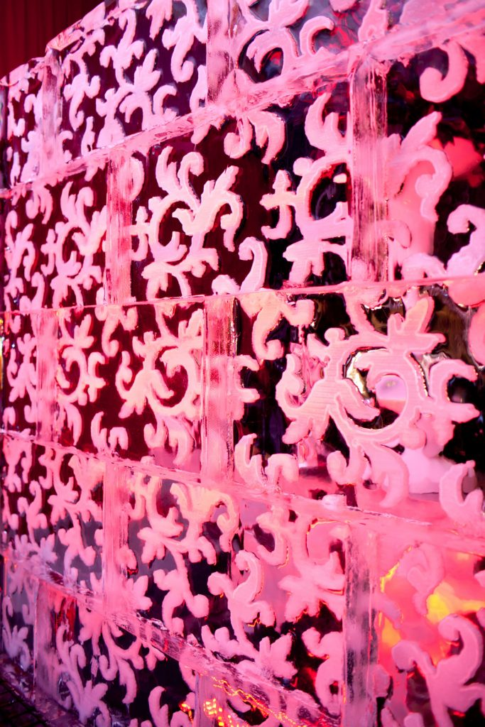 Intricately patterned ice wall at wedding