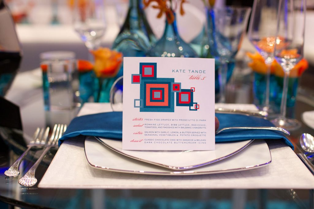 Retro blue and orange square menus at wedding
