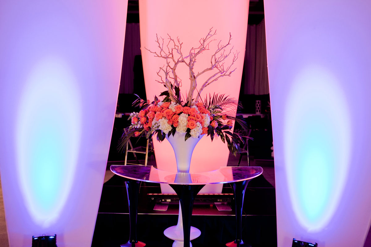 Spandex lit towers and acrylic alter at the Trend Wedding Experience