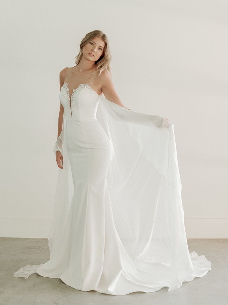 Plunging neckline beaded bridal gown with cape
