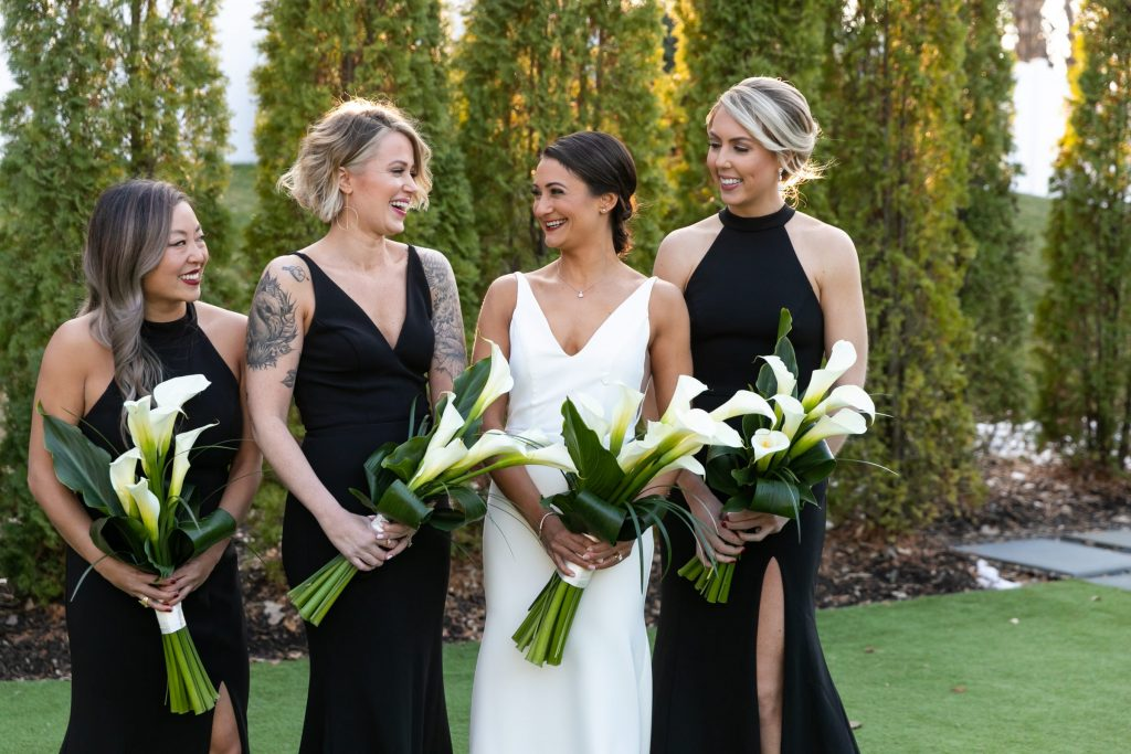 Bridesmaids in black dresses by BHLDN