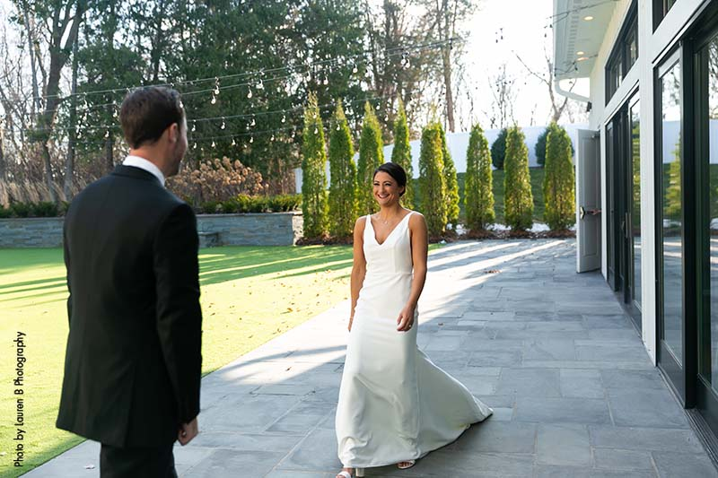 Bride and groom share first look outside of The Hutton House