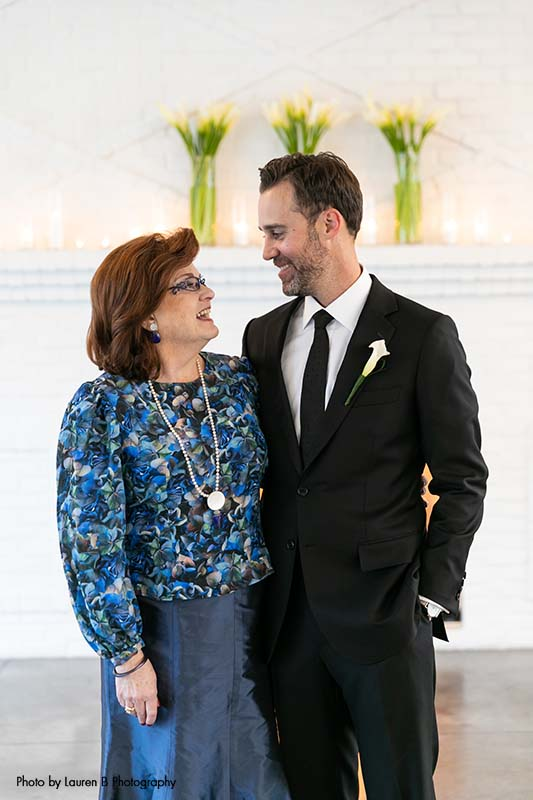Groom stands with his mother before wedding