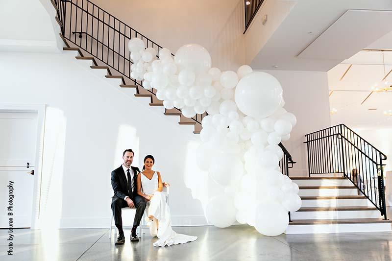 White balloon installation at wedding