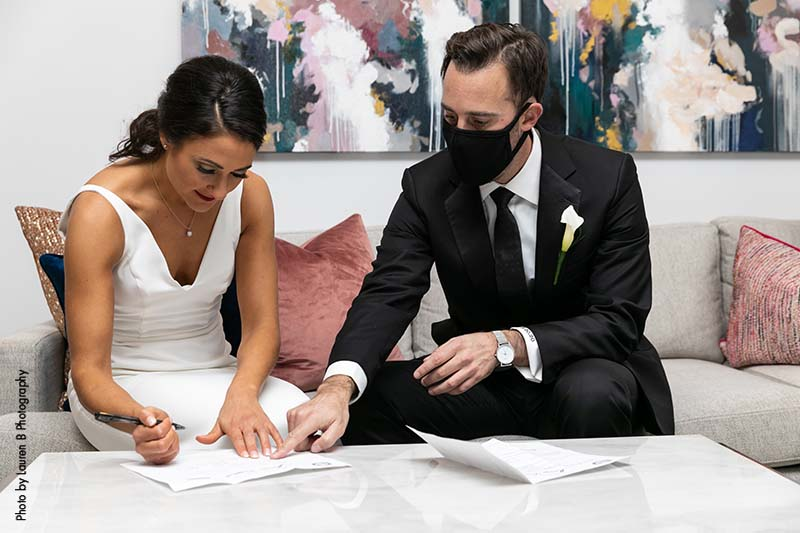 Couple signs marriage license