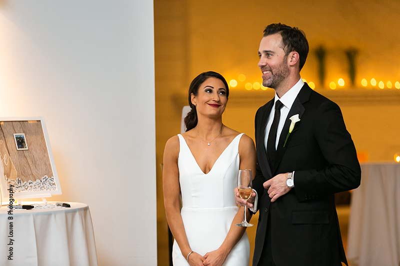 Bride and groom give toast at modern minimalist wedding