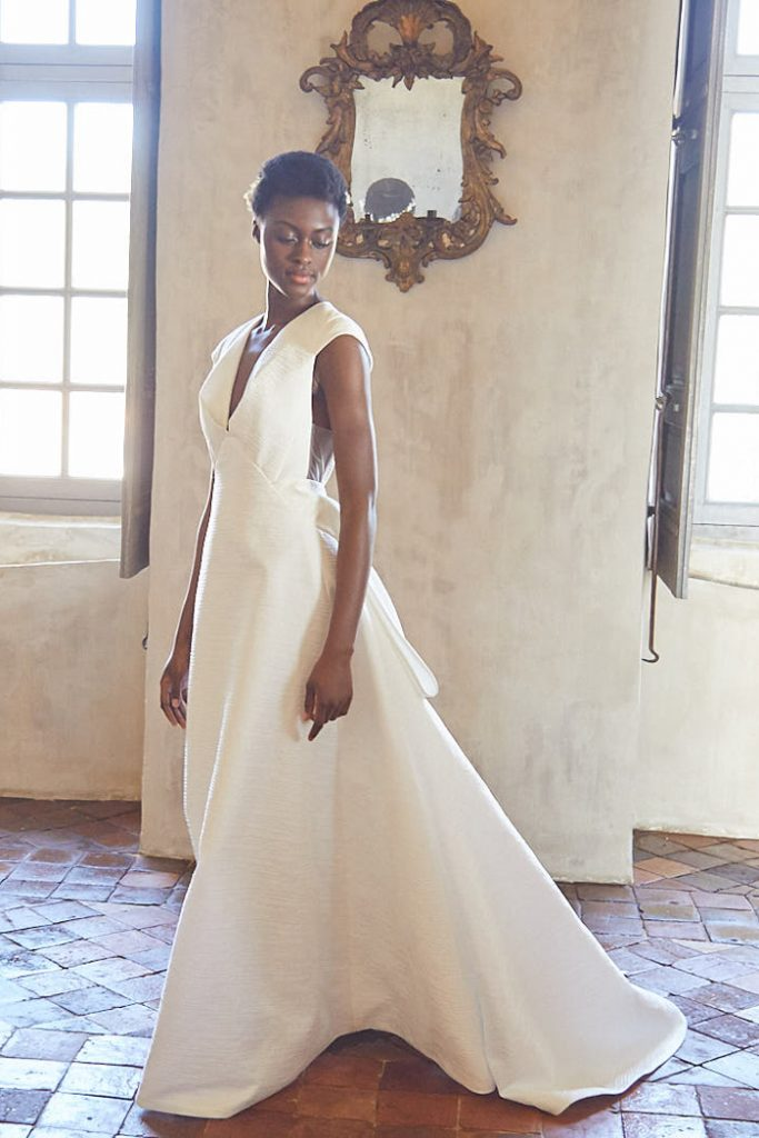 Jacquard bridal gown with cup sleeves and deep v neckling