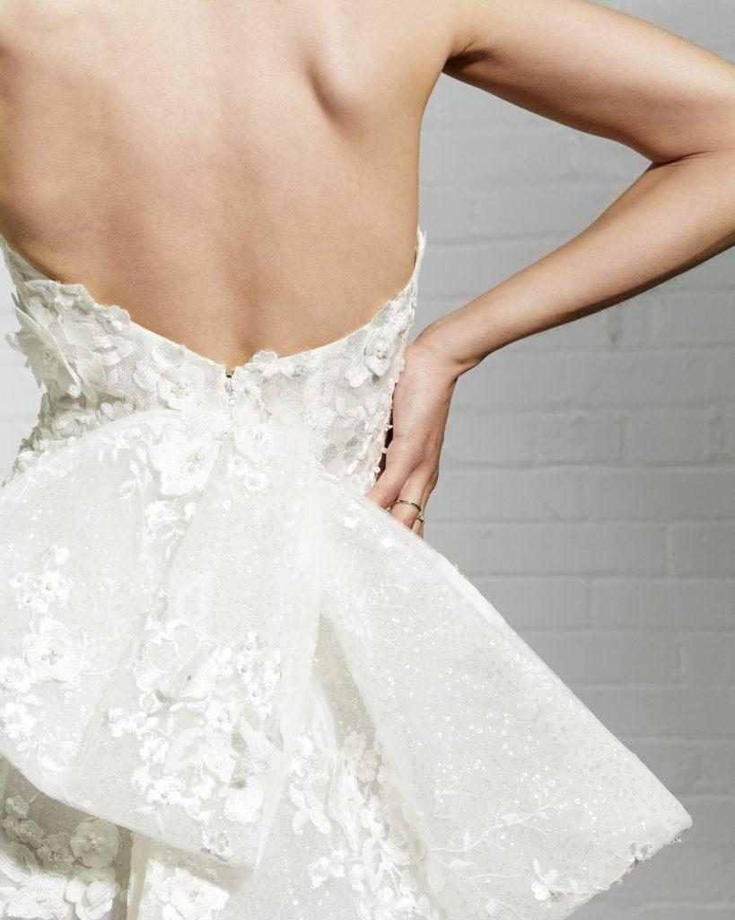Floral applique bow on wedding dress