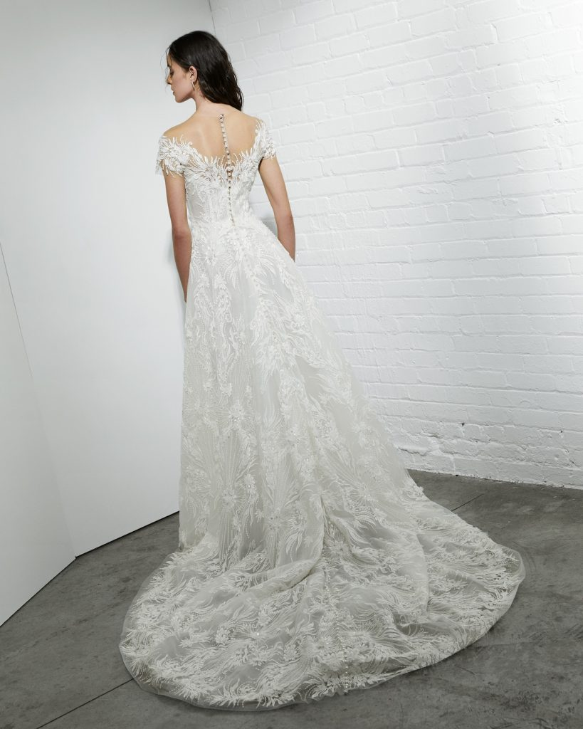 A-line gown with off-the-shoulder sleeves and illusion neckline