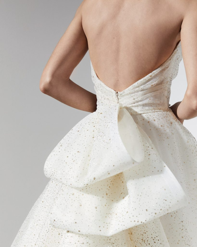 Large gold speckled bow on the back of wedding gown