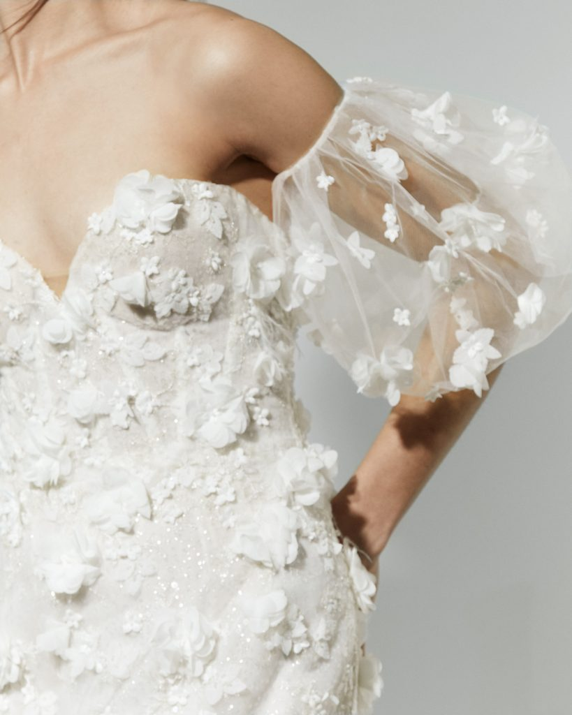3D floral wedding gown with feathers and shimmer lace
