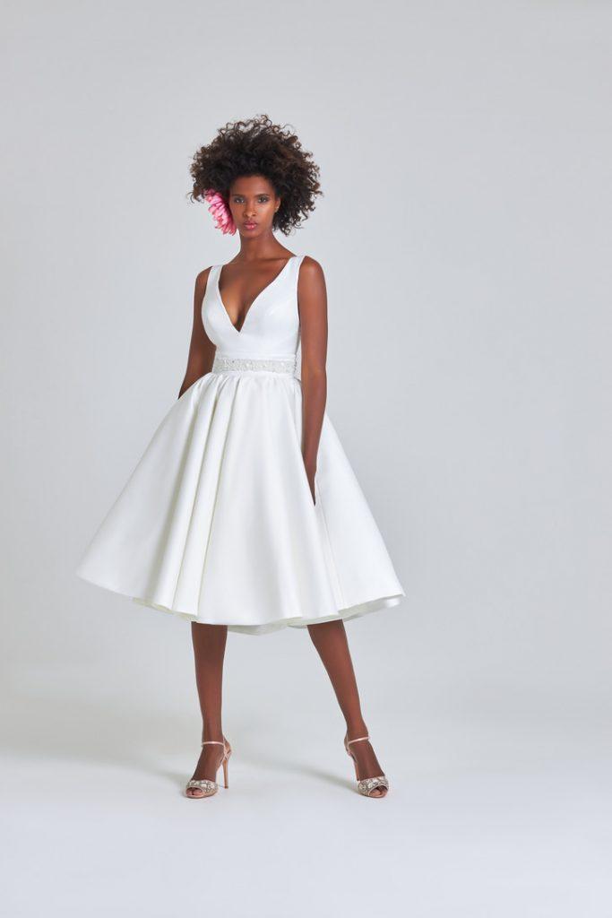 Tea-length bridal gown with v-neckline