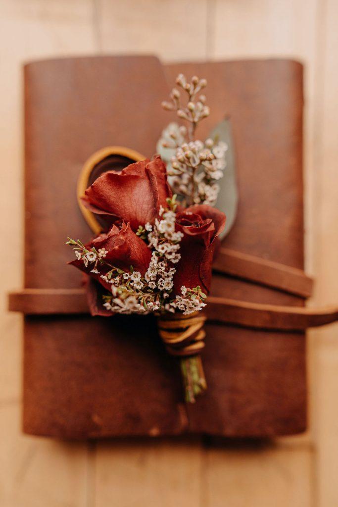 Orange fall boutonniere for wedding