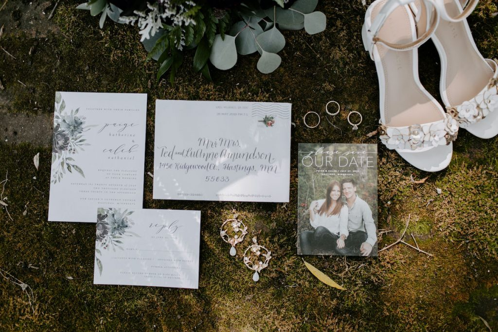 White and greenery wedding invitations with calligraphy