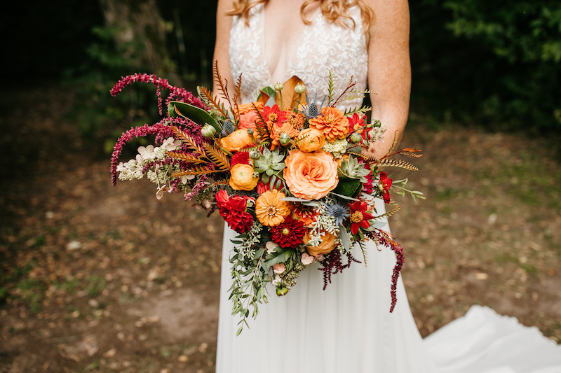 Orange and red fall floral for bride