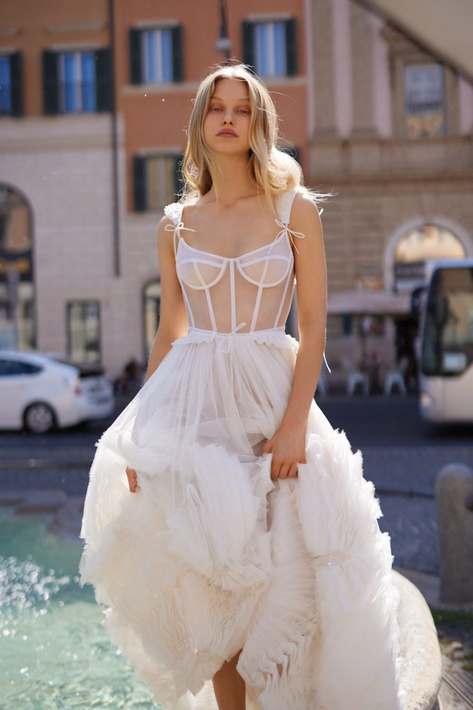Wedding gown with corset bodice and ruffled skirt