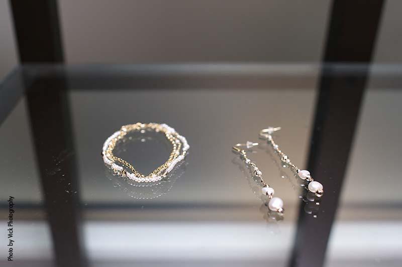 Silver bridal bracelet and dangly pearl earrings