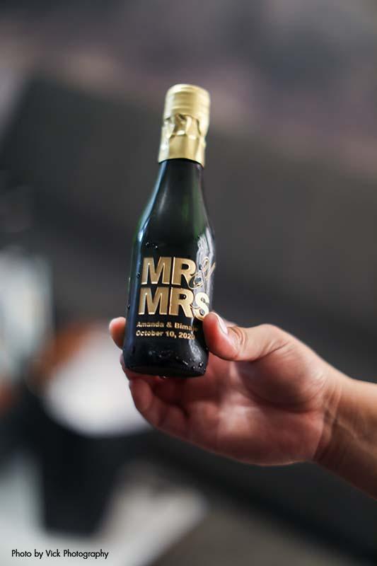 "Mini champagne bottle that says ""Mr"" & ""Mrs."""