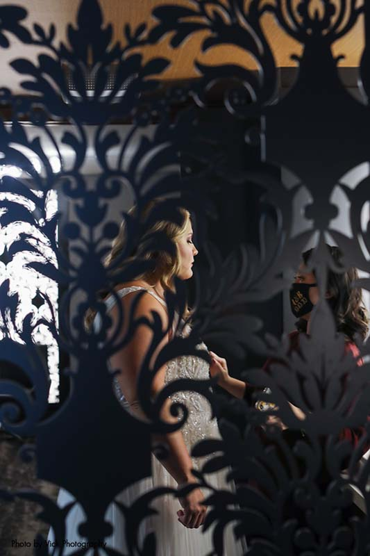 Photo of a reflection of the bride in a mirror