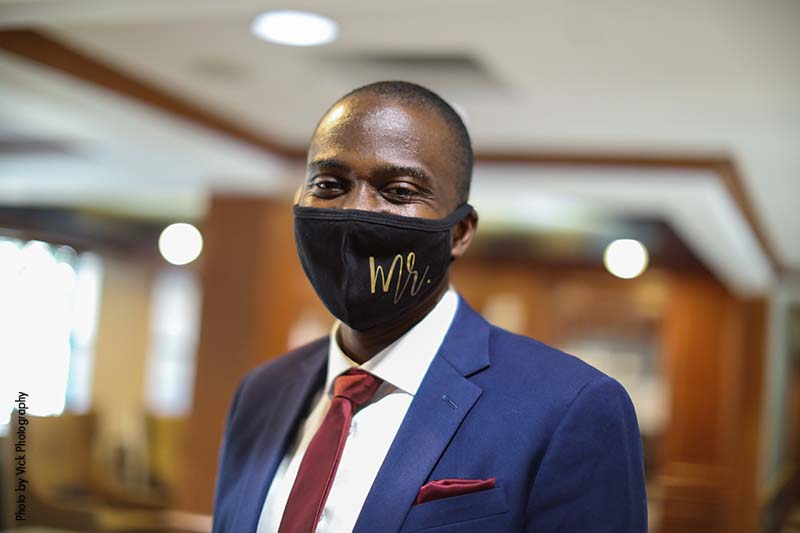 """Groom in black face mask that says """"Mr."""""""