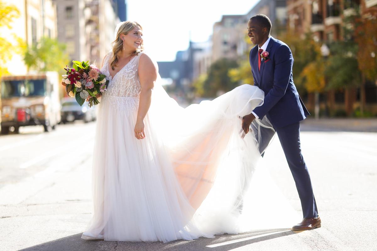 Couple walks down the street at their fall Minneapolis wedding
