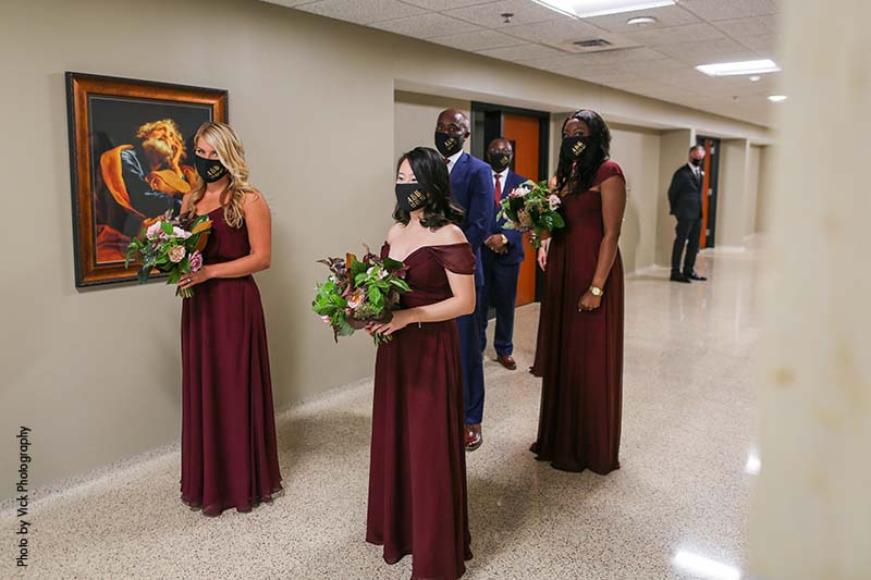 Bridal party in maroon gowns social distancing