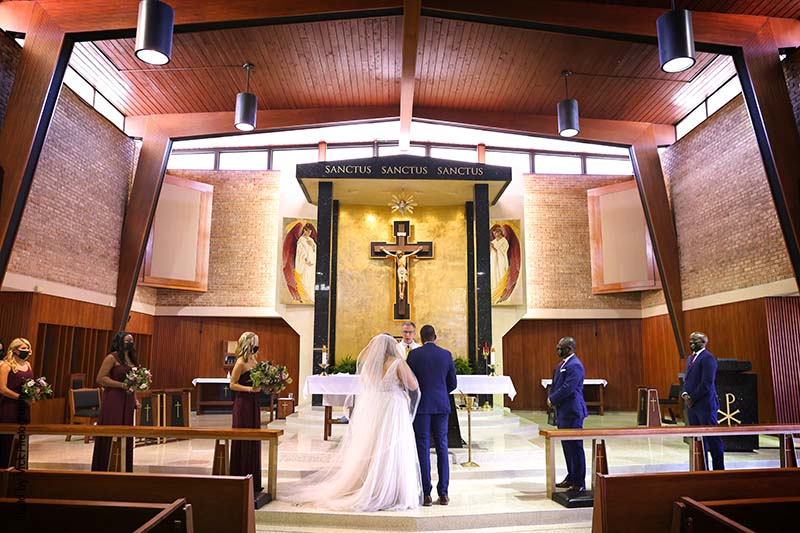Couple stands at alter for Catholic wedding ceremony