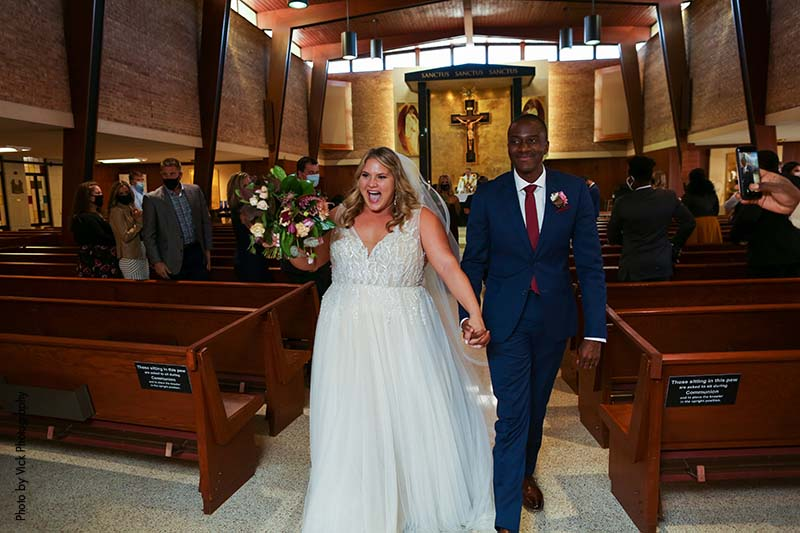 Bride and groom celebrate marriage ceremony in church