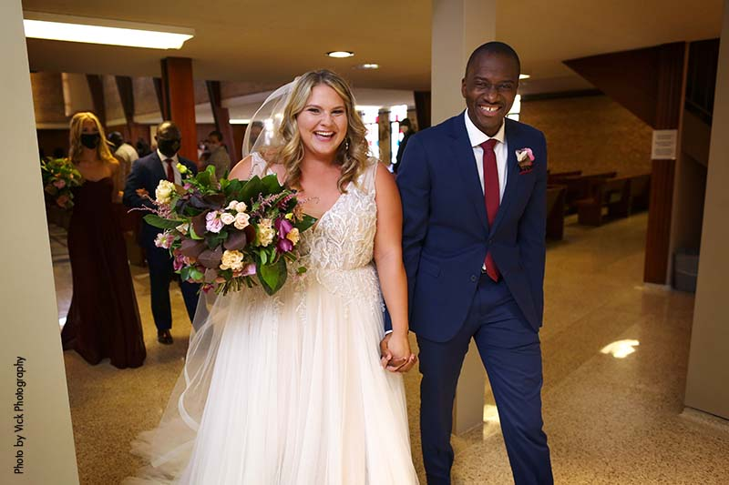 Bride and groom exit church after wedding ceremony in Minneapolis
