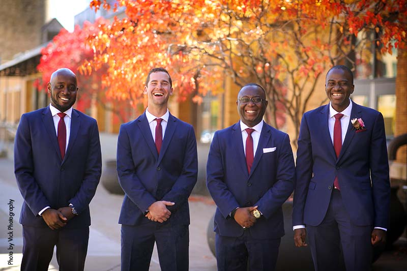Groomsmen in Minneapolis pose for photo in navy suits