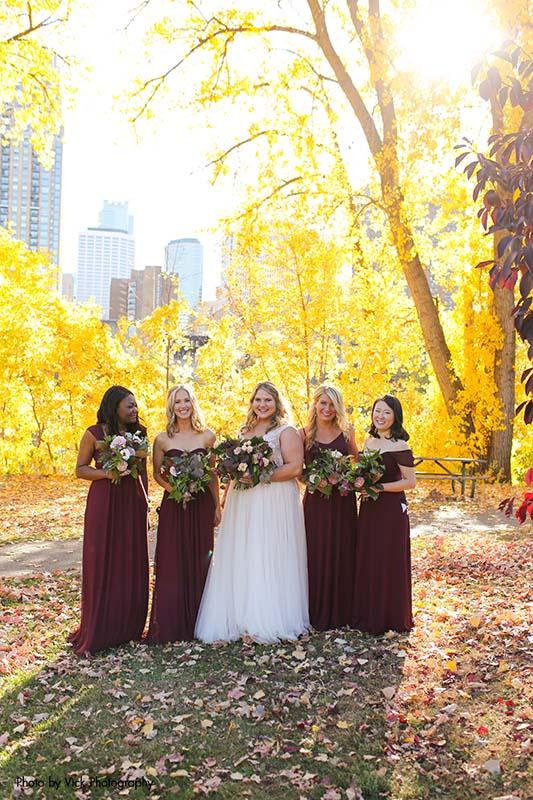 Bridesmaids in maroon dresses