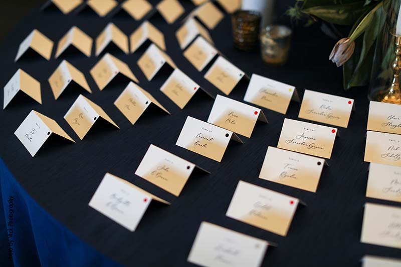 Simple escort cards on table at wedding