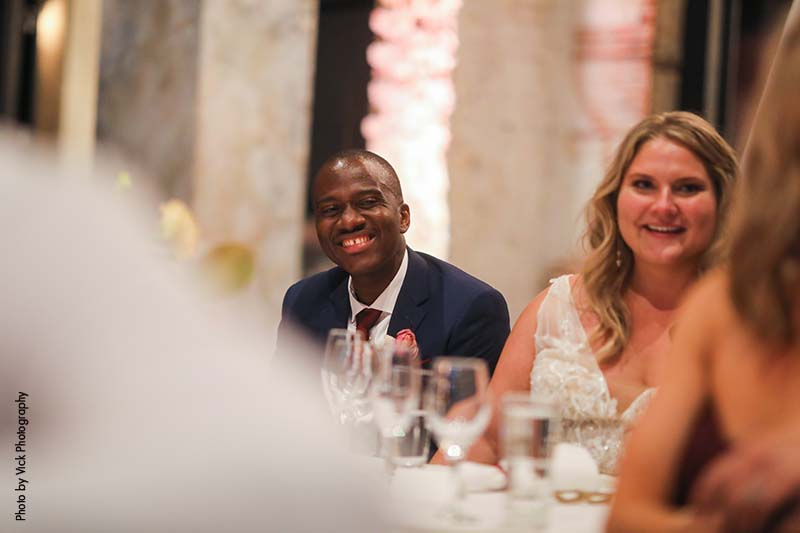 Bride and groom laugh at speeches