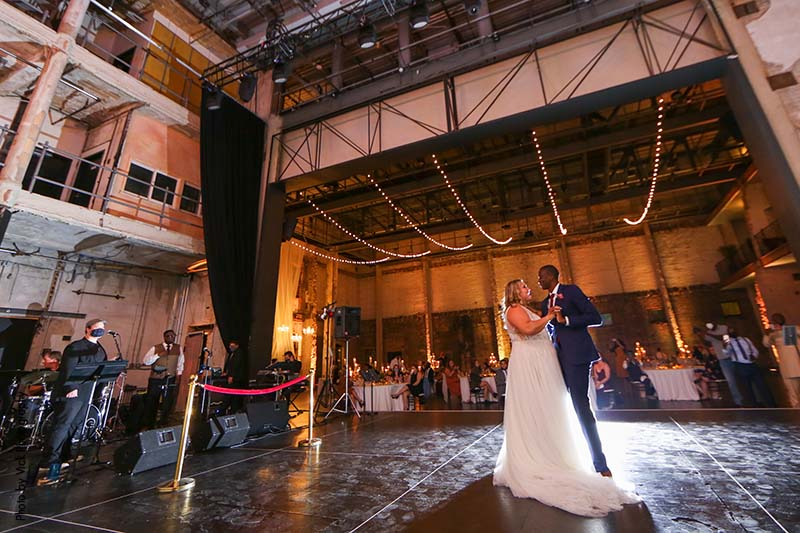 Bride and groom share first dance at Minneapolis industrial venue