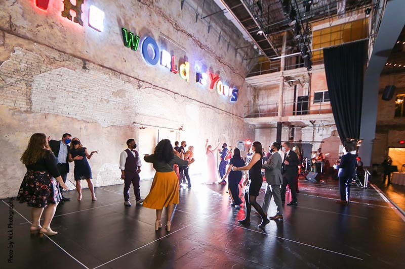 Crowd socially distances at wedding dance in Minneapolis