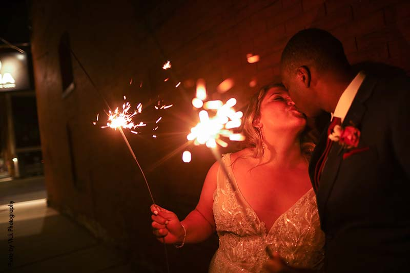 Wedding sparkler photo of bride and groom