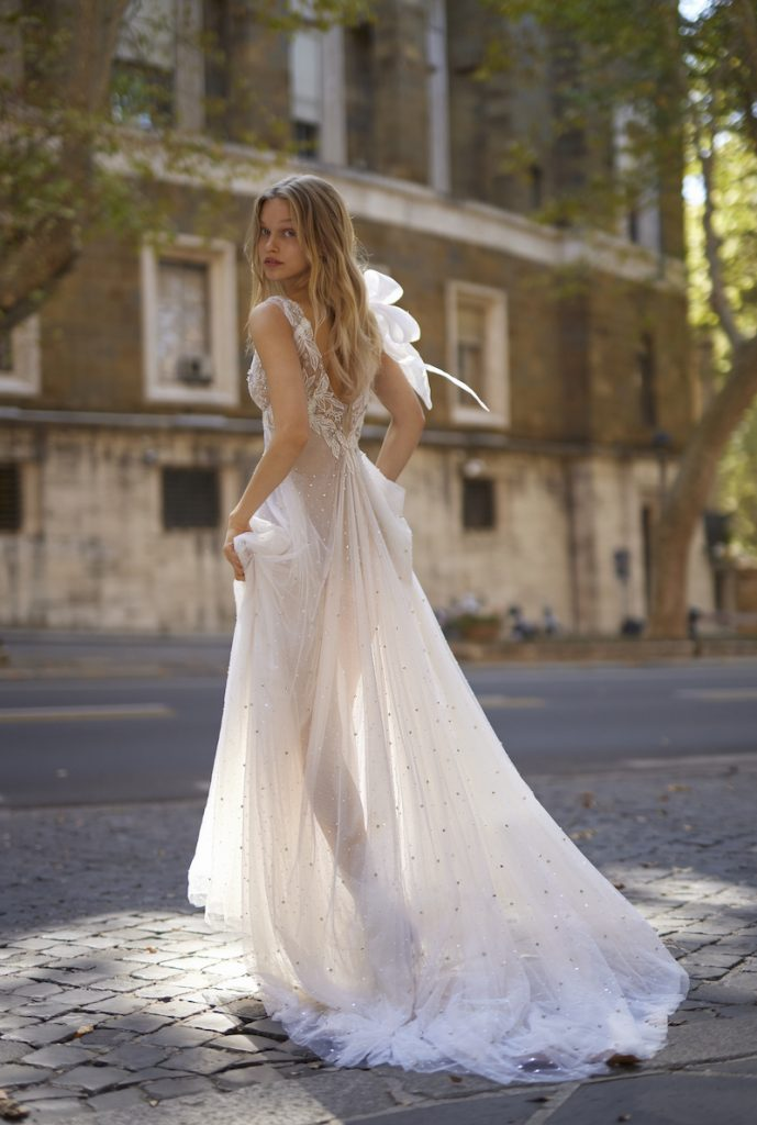 Sheer tulle wedding gown with scattered pearls